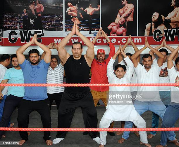 WWE wrestler Dalip Singh also known as The Great Khali' performs yoga on International Yoga Day on June 21 2015 in Jalandhar India He performed some...