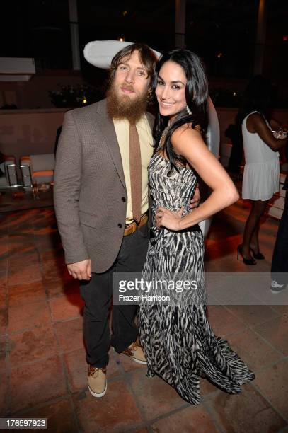 Wrestler Daniel Bryan and WWE Diva Brie Bella attend WWE E Entertainment's 'SuperStars For Hope' at the Beverly Hills Hotel on August 15 2013 in...