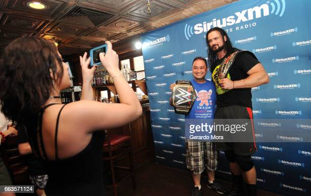 Wrestler Drew Galloway poses with a fan during the SiriusXM's Busted Open Live From WrestleMania 33on April 1 2017 in Orlando City