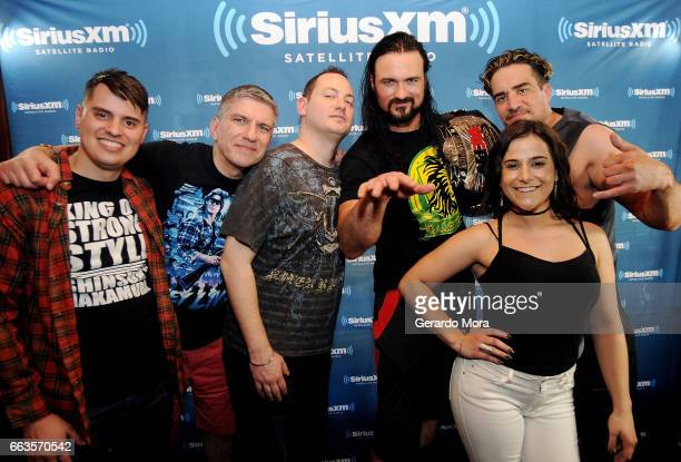 Wrestler Drew Galloway poses with the Busted Open crew Alex Metz Dave LaGreca Doug Mortman Larry Dallas and Marissa Rives during SiriusXM's Busted...