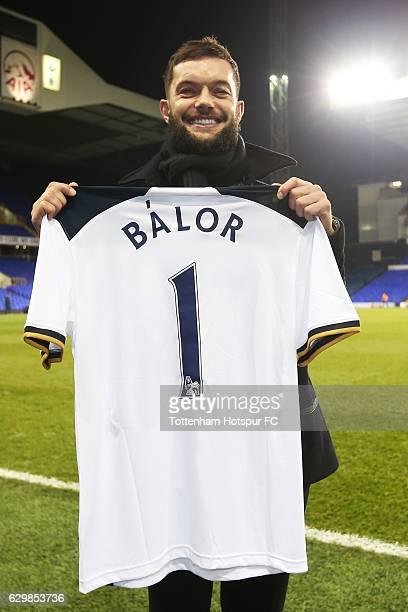 WWE wrestler Finn Balor poses for photograph with Tottenham Hotspur shirt after the Premier League match between Tottenham Hotspur and Hull City at...