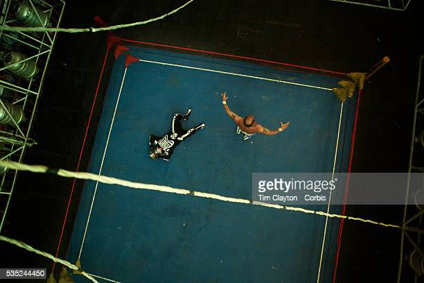 Wrestler Gran Mortis dressed in a skeleton outfit lies prone on the canvas after his defeat to Veteran 'campeon Legendario' Mister Atlas during the...
