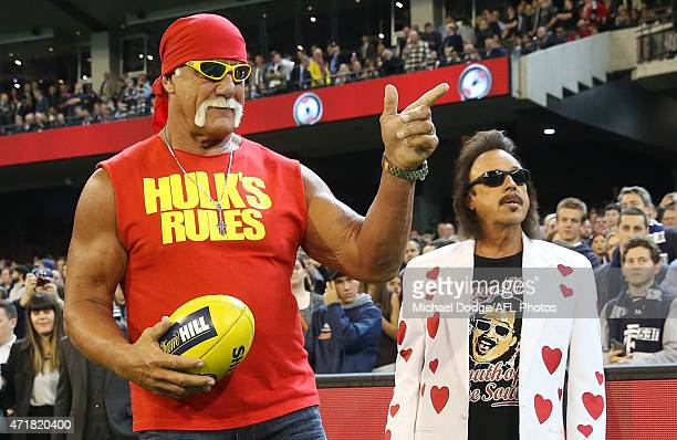 Wrestler Hulk Hogan gestures to the crowd while making an appearance during the round five AFL match between the Carlton Blues and the Collingwood...