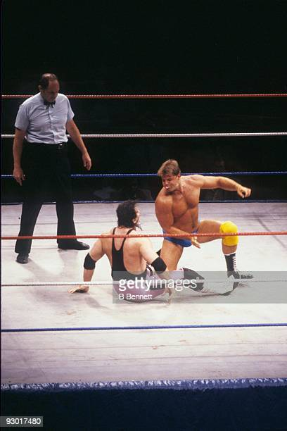 WWF Wrestler Jacques Rougeau slams Bret 'Hit Man' Hart during a WWF match on July 17 1987 at Nassau Coliseum in New York New York