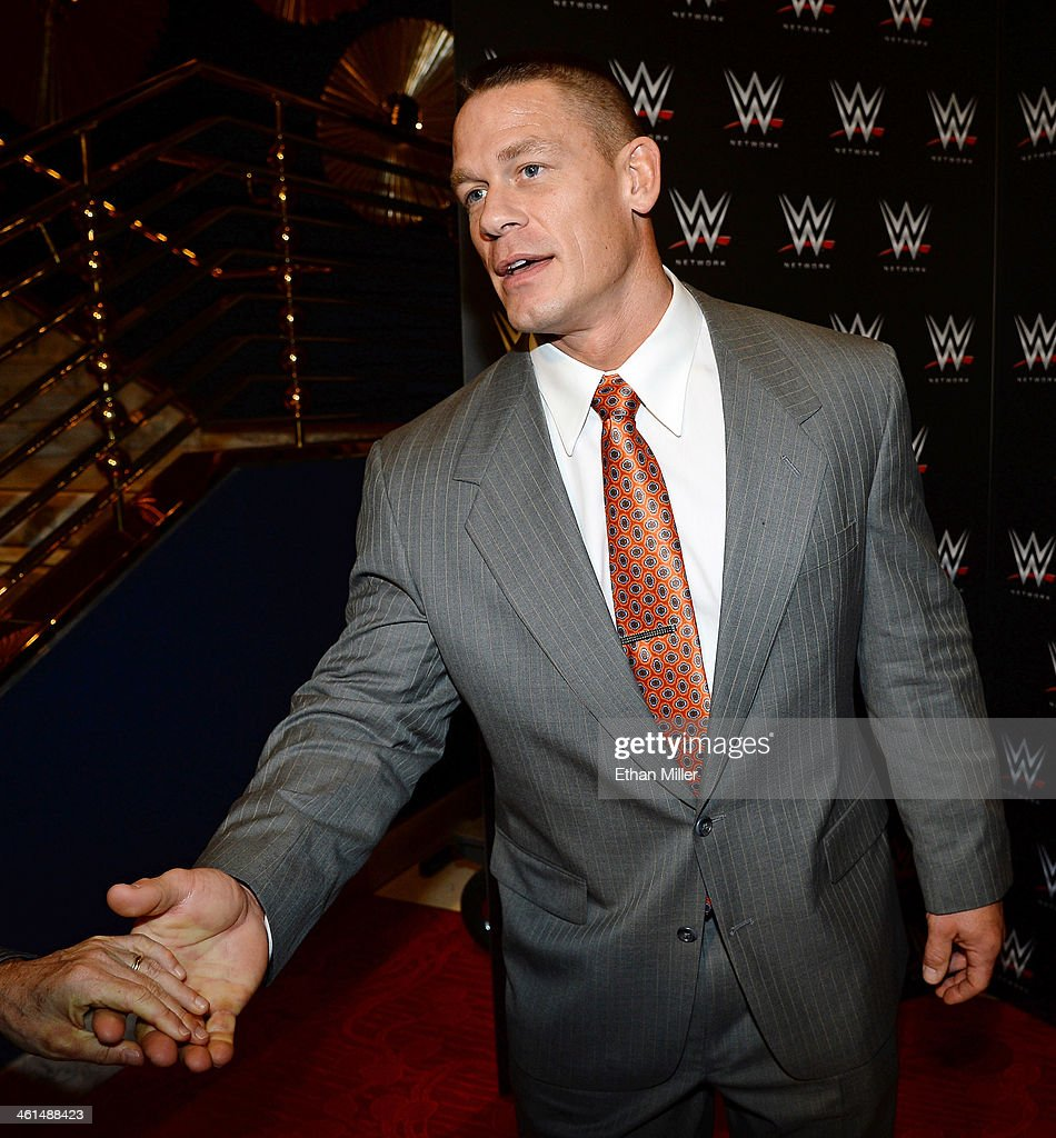 WWE wrestler John Cena appears at a news conference announcing the WWE Network at the 2014 International CES at the Encore Theater at Wynn Las Vegas on January 8, 2014 in Las Vegas, Nevada. The network will launch on February 24, 2014 as the first-ever 24/7 streaming network, offering both scheduled programs and video on demand. The USD 9.99 per month subscription will include access to all 12 live WWE pay-per-view events each year. CES, the world's largest annual consumer technology trade show, runs through January 10 and is expected to feature 3,200 exhibitors showing off their latest products and services to about 150,000 attendees.