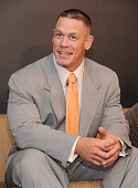 Wrestler John Cena visits children from the Garden of Dreams Foundation at the Madison Square Garden Transformation Center on March 18 2011 in New...