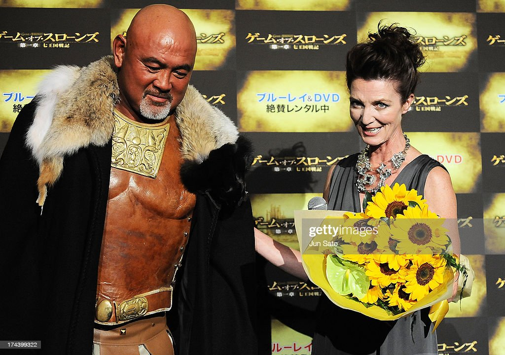 Wrestler Keiji Muto and Actress <a gi-track='captionPersonalityLinkClicked' href=/galleries/search?phrase=Michelle+Fairley&family=editorial&specificpeople=5745645 ng-click='$event.stopPropagation()'>Michelle Fairley</a> attend the 'Game of Thrones' stage greeting at Toho Cinemas Roppongi Hills on July 25, 2013 in Tokyo, Japan.