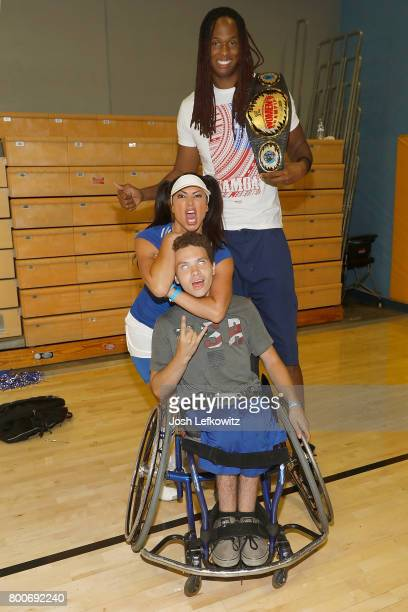 Wrestler Lisa Marie Varon and Jay 'Stretch' Middleton pose for a photograph before the 3rd Annual Celebrity Wheelchair Basketball Game at the John...