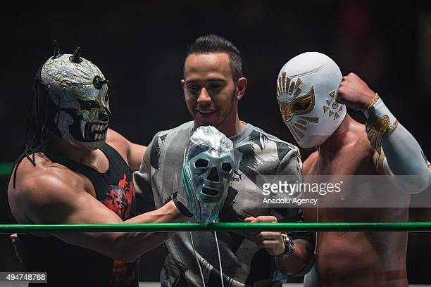 Wrestler Mephisto Lewis Hamilton and Mistico are seen during a promotional event at 'Lucha Libre' arena in Mexico City Wednesday Oct 28 2015 Mexico...
