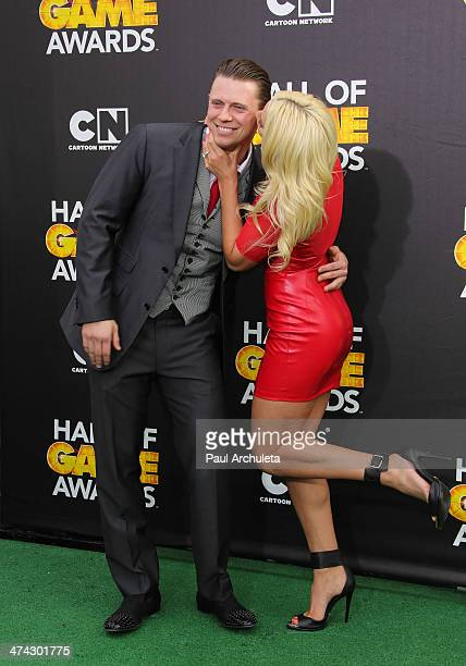 Wrestler Michael Mizanin and his Girlfriend Maryse Ouellet attend the Cartoon Network's Hall Of Game Awards at Barker Hangar on February 15 2014 in...