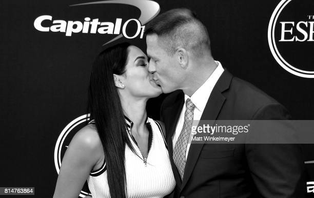 Wrestler Nikki Bella and actor/wrestler John Cena kiss on the red carpet during the 2017 ESPYS at Microsoft Theater on July 12 2017 in Los Angeles...