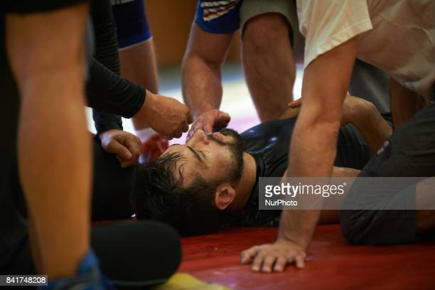 A wrestler of the TOAC Wrestling Club was knocking down during a warmup Other wrestlers take care of him before calling emergency services The...