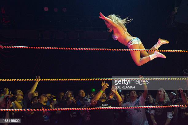 A wrestler performs during the Lucha Va Voom's Cinco de Mayan show at the Mayan Theatre in downtown Los Angeles California on May 5 2013 Lucha Va...