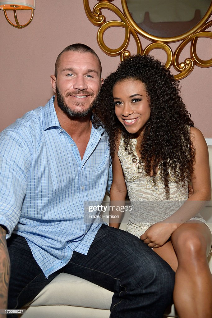 WWE wrestler Randy Orton (L) and WWE Diva JoJo attend WWE & E! Entertainment's 'SuperStars For Hope' at the Beverly Hills Hotel on August 15, 2013 in Beverly Hills, California.