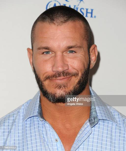 WWE wrestler Randy Orton arrives at WWE and E Entertainment's 'Superstars For Hope' at Beverly Hills Hotel on August 15 2013 in Beverly Hills...