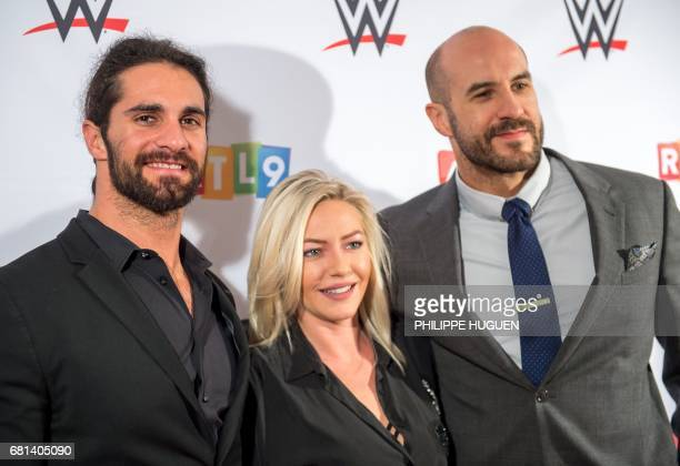 US wrestler Seth Rollins and Swiss wrestler Cesaro pose with Tressia a contestant of French TV reality show ''Les Ch'tis'' before the World Wrestling...
