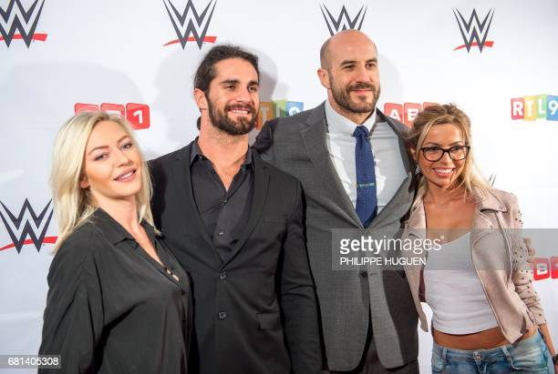 US wrestler Seth Rollins and Swiss wrestler Cesaro pose with Tressia and Hillary Aventurier contestants of French TV reality show ''Les Ch'tis''...
