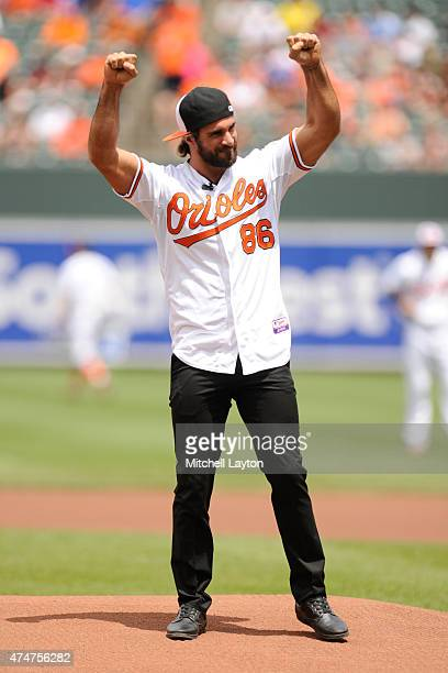 WWE wrestler Seth Rollins celebrates after throwing out the first pitch before a baseball game between Baltimore Orioles and the Los Angeles Angels...
