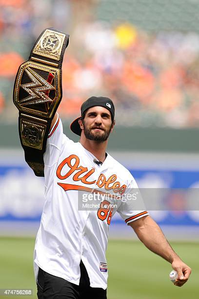 WWE wrestler Seth Rollins looks on after throwing out the first pitch before a baseball game between Baltimore Orioles and the Los Angeles Angels at...
