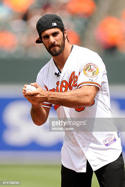 WWE wrestler Seth Rollins throws out the first pitch before a baseball game between Baltimore Orioles and the Los Angeles Angels at Oriole Park at...