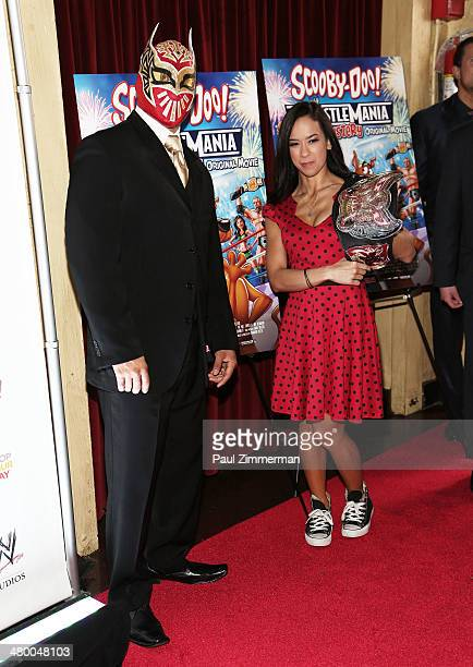 WWE wrestler SIn Cara and WWE Diva AJ Lee attend the 'Scooby Doo WrestleMania Mystery' New York Premiere at Tribeca Cinemas on March 22 2014 in New...