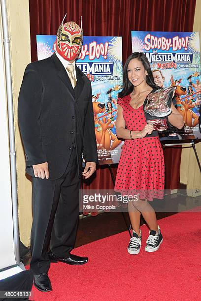 Wrestler Sin Cara and WWE Diva AJ Lee attend the 'Scooby Doo WrestleMania Mystery' New York Premiere at Tribeca Cinemas on March 22 2014 in New York...