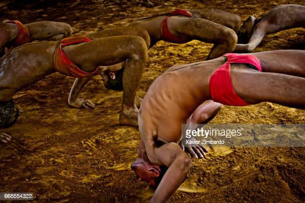 Wrestler training during Kushti the ancient tradition of sacred Indian wrestling on October 24 2005 at Varanasi Uttar Pradesh India The sand and mud...