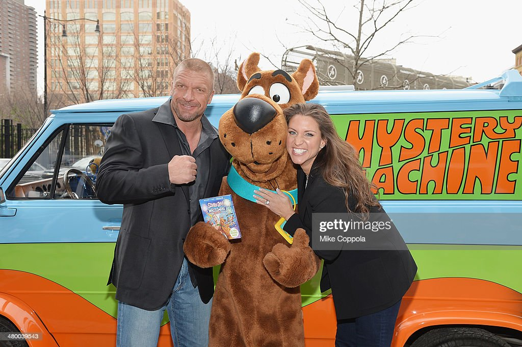 WWE wrestler Triple H Scooby Doo and Stephanie McMahon pose for a picture during the 'Scooby Doo WrestleMania Mystery' New York Premiere at Tribeca...