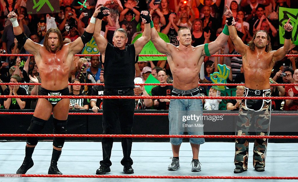 Wrestler Triple H, World Wrestling Entertainment Inc. Chairman Vince McMahon, and wrestlers John Cena and Shawn Michaels pose in the ring during the WWE Monday Night Raw show at the Thomas & Mack Center August 24, 2009 in Las Vegas, Nevada.