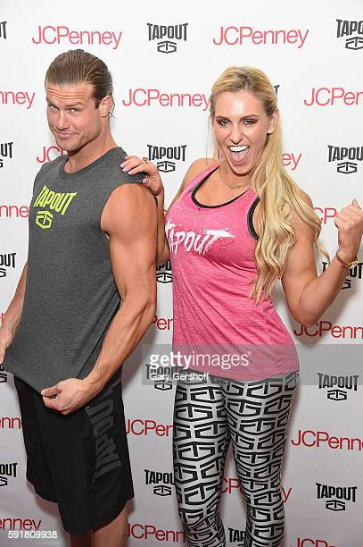 WWE wrestlers and Tapout Ambassadors Dolph Ziggler and Charlotte attend a 'meet and greet' with shoppers to promote Tapout Women's performance...