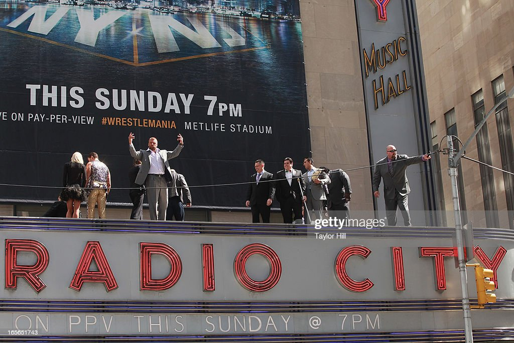 Wrestlers atop the marquee at WrestleMania 29 Press Conference at Radio City Music Hall on April 4, 2013 in New York City.