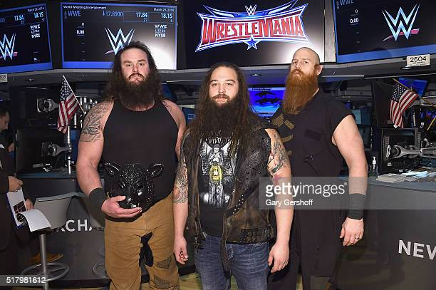 WWE wrestlers Braun Strowman Bray Wyatt and Erick Rowan pose for a picture prior to ringing the New York Stock Exchange opening bell in honor of...