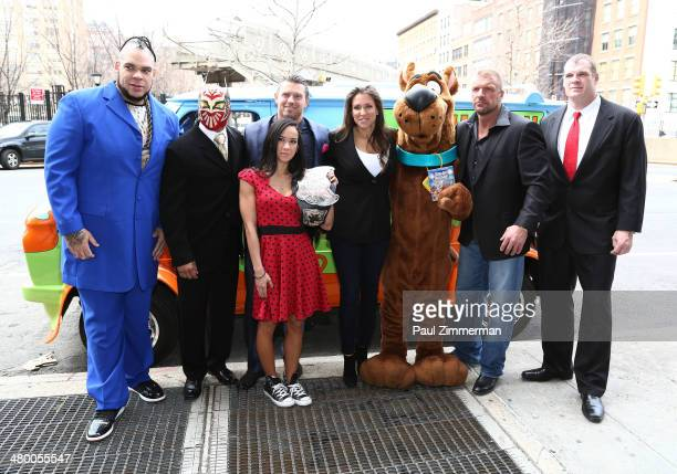 WWE Wrestlers Brodus Clay Sin Cara The Miz Diva AJ Lee WWE Chief Brand Officer Stephanie McMahon Scooby Doo WWE Wrestlers Triple H and Kane pose for...