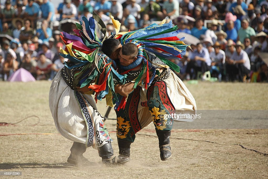 Wrestlers compete during the annual Naadam festival on July 29 2014 in Xilinhot Inner Mongolia Autonomous Region of China Around 768 people attended...