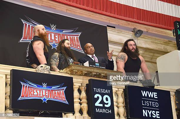WWE wrestlers Erik Rowan and Bray Wyatt Global Head of Capital Markets at NYSE Garvis Toler and WWE wrestler Braun Strowman ring the New York Stock...