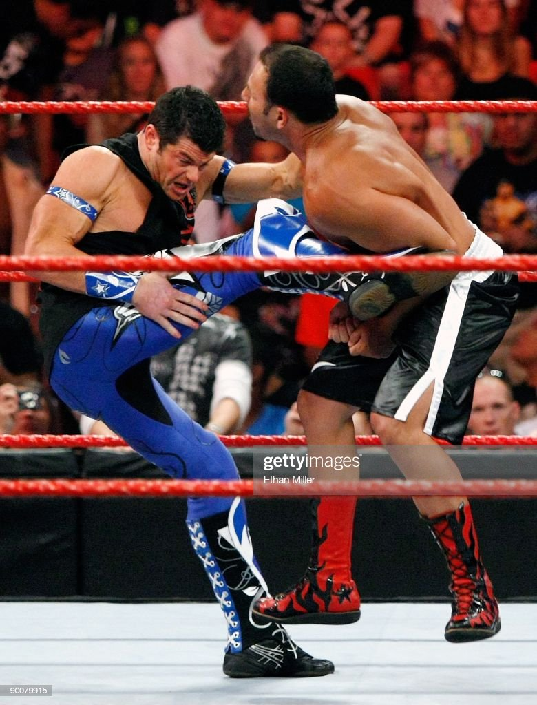 Wrestlers Evan Bourne (L) kicks Chavo Guerrero during the WWE Monday Night Raw show at the Thomas & Mack Center August 24, 2009 in Las Vegas, Nevada.