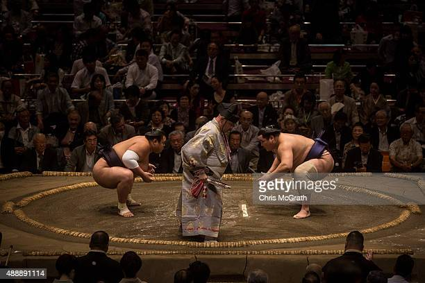 Wrestlers face off during the Tokyo Grand Sumo tournament at the Ryogoku Kokugikan on September 17 2015 in Tokyo Japan Japanese Sumo is an anciant...