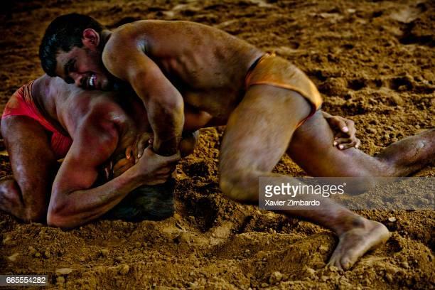 Wrestlers fighting during their Kushti training the ancient tradition of sacred Indian wrestling on October 24 2005 at Varanasi Uttar Pradesh India...