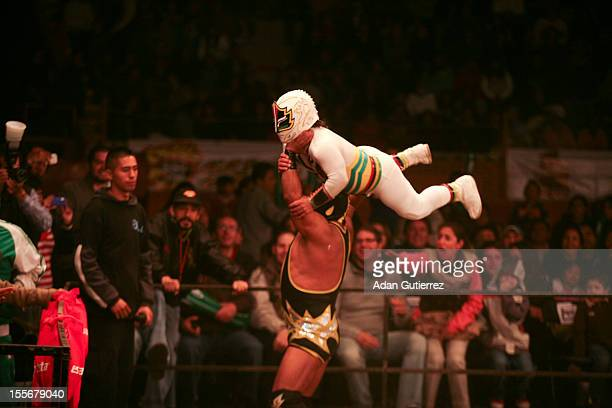 Wrestlers in action during the Wrestling Championship Gigantes del Ring NRM conducted by Núcleo Radio Mil on November 02 2012 in Mexico City Mexico