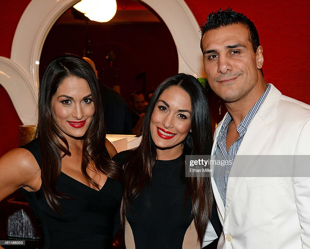 WWE wrestlers (L-R) Nikki Bella, her twin sister Brie Bella and Alberto Del Rio appear at a news conference announcing the WWE Network at the 2014 International CES at the Encore Theater at Wynn Las Vegas on January 8, 2014 in Las Vegas, Nevada. The network will launch on February 24, 2014 as the first-ever 24/7 streaming network, offering both scheduled programs and video on demand. The USD 9.99 per month subscription will include access to all 12 live WWE pay-per-view events each year. CES, the world's largest annual consumer technology trade show, runs through January 10 and is expected to feature 3,200 exhibitors showing off their latest products and services to about 150,000 attendees.