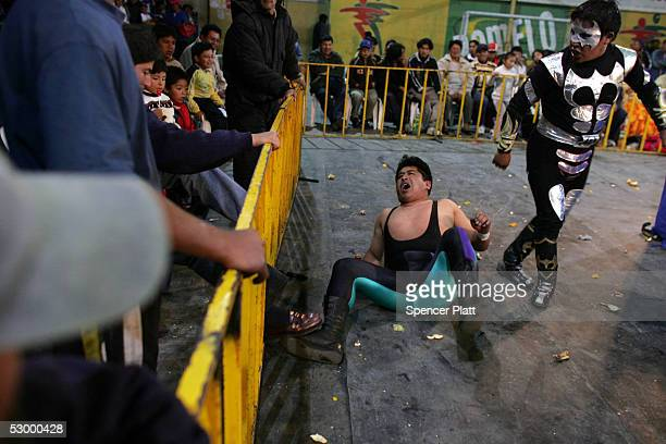 Wrestlers perform during a 'Lucha Libre' or freedom wrestling match May 29 2005 in El Alto Bolivia The matches are hugely popular in El Alto a...