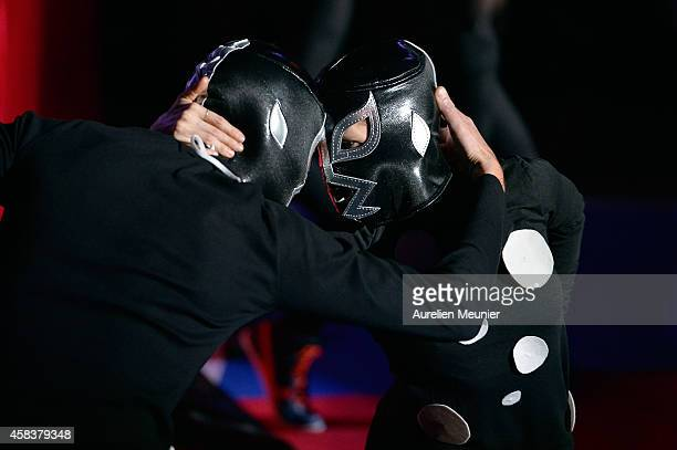 Wrestlers performs onstage during the EXOTICOS VS LUCHADORES Lucha Libre Show hosted by La Fondation Cartier in Paris on November 3 2014 in Paris...