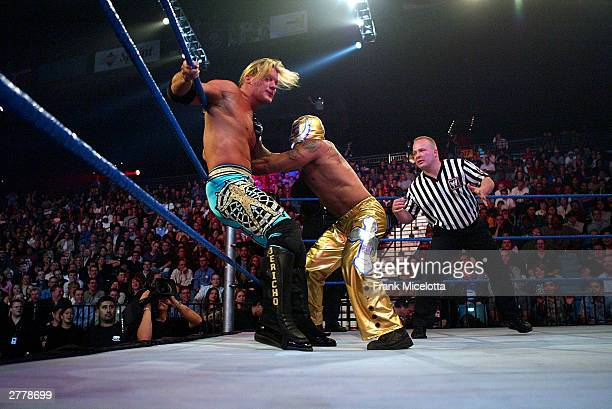 WWE wrestlers Rey Mysterio and Chris Jericho perform on stage during the '1st Annual Video Game Awards' at the MGM Grand Garden Arena December 2 2003...