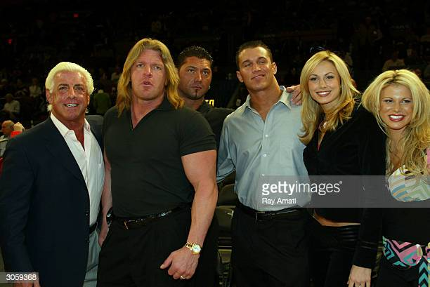 WWE wrestlers Ric Flair Triple H Batista Randy Orton Stacy Keibler Miss Jackie attend the New York Knicks v Boston Celtics NBA game March 9 2004 at...