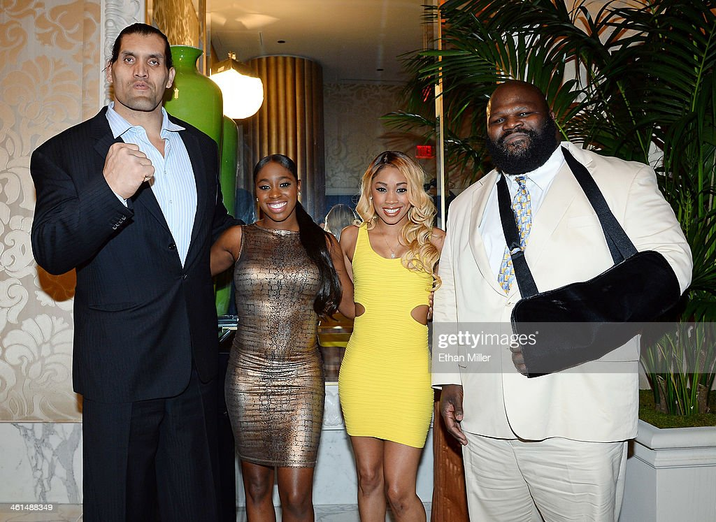 WWE wrestlers (L-R) The Great Khali, Naomi, Cameron Lynn and Mark Henry appear at a news conference announcing the WWE Network at the 2014 International CES at the Encore Theater at Wynn Las Vegas on January 8, 2014 in Las Vegas, Nevada. The network will launch on February 24, 2014 as the first-ever 24/7 streaming network, offering both scheduled programs and video on demand. The USD 9.99 per month subscription will include access to all 12 live WWE pay-per-view events each year. CES, the world's largest annual consumer technology trade show, runs through January 10 and is expected to feature 3,200 exhibitors showing off their latest products and services to about 150,000 attendees.