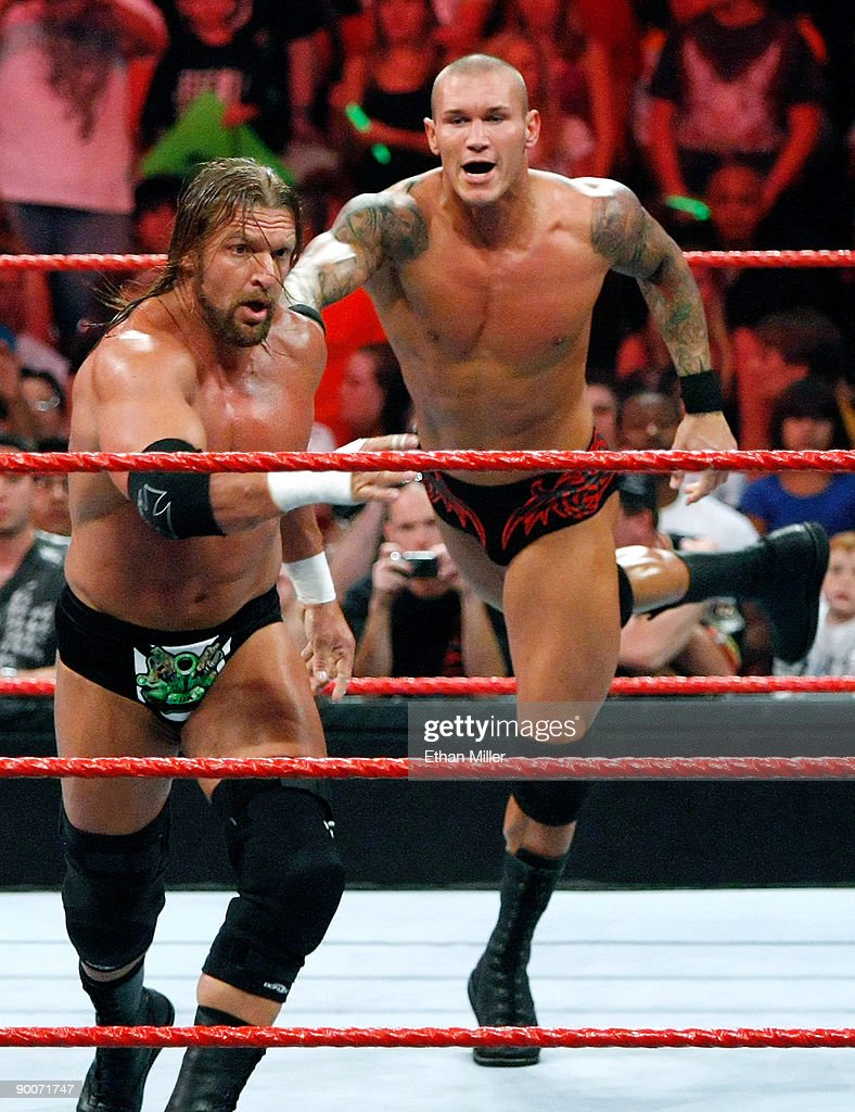 Wrestlers Triple H (L) and Randy Orton compete during the WWE Monday Night Raw show at the Thomas & Mack Center August 24, 2009 in Las Vegas, Nevada.