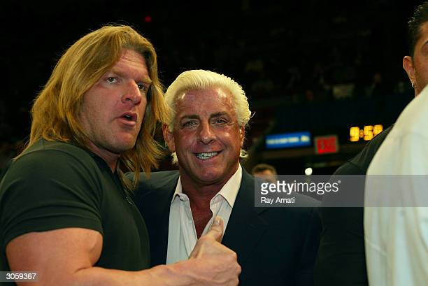 WWE wrestlers Triple H and Ric Flair attend the New York Knicks v Boston Celtics NBA game March 9 2004 at Madison Square Garden in New York City