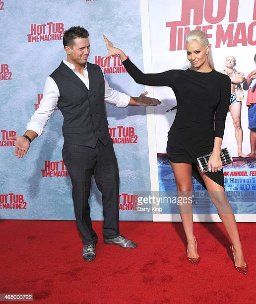 Wrestler/tv personality Mike 'The Miz' Mizanin and his wife Maryse Ouellet attend the premiere of 'Hot Tub Time Machine 2' at Regency Village Theatre...