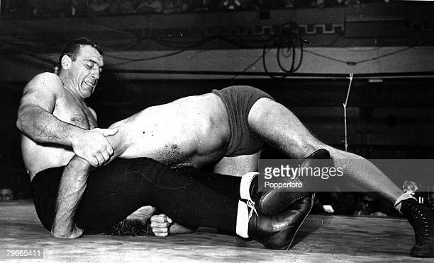 Wrestling 9th May 1946 New York USA Primo Carnera the exHeavyweight boxer is pictured holding down an opponent during his wrestling debut