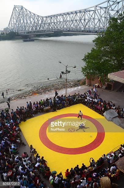 Wrestling competition organised by the local boys and girls are called Kusti at Mallik Ghat Kolkata India during the Ram Navami festival on Saturday...